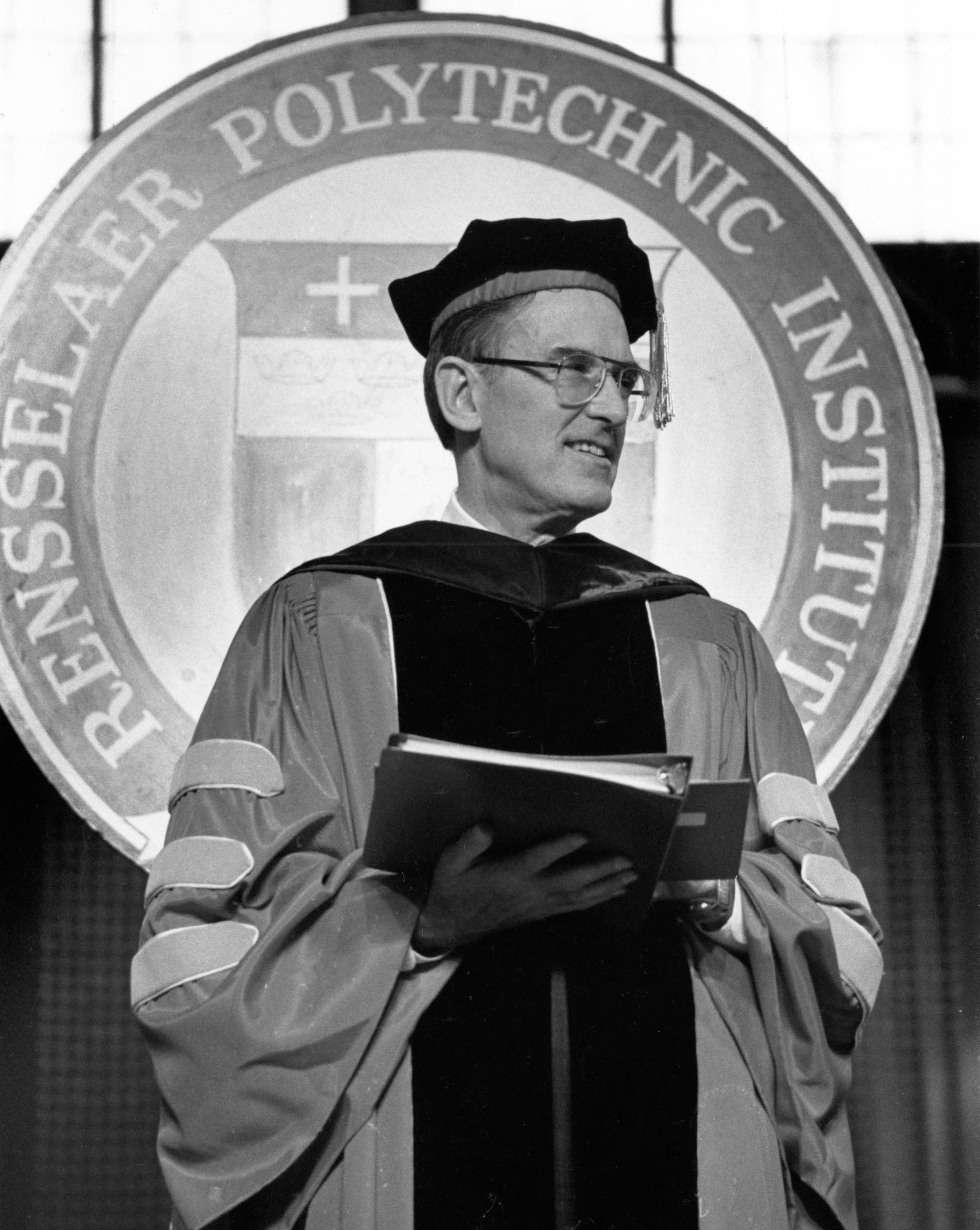 Black-and-white photograph of Daniel Berg wearing Rensselaer academic regalia, presumably at one of the Institute's Commencement ceremonies