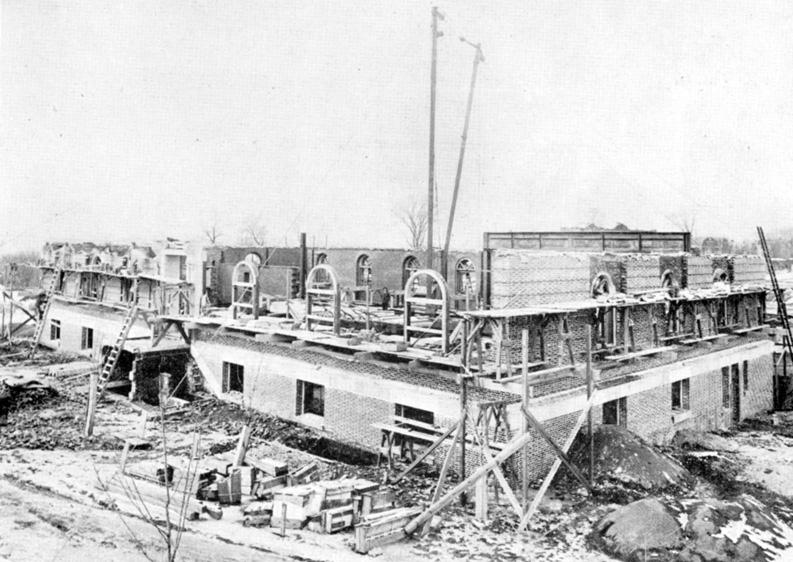 87 Gym April 1912 – masonry completed to second story – girders for the second floor in place.