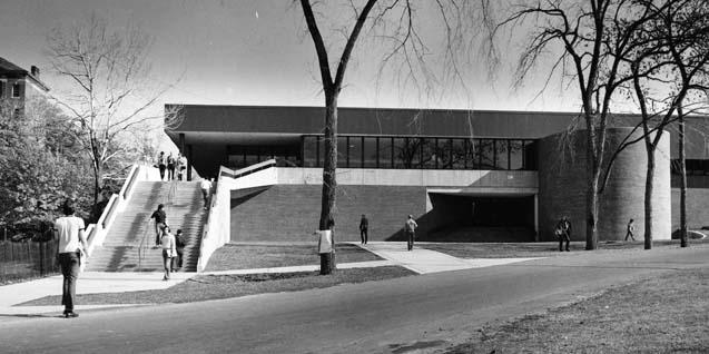 Exterior view of the Darrin Communication Center, with students shown walking outside the building (west elevation angled slightly upwward, date unknown)
