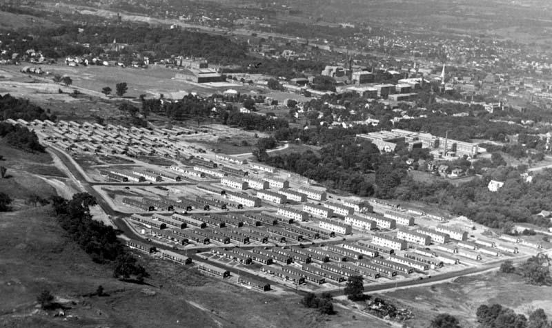 Aerial photograph of Rensselaerwyck housing development, probably circa 1946 (looking south-southwest; Armory and other campus buildings visible, with Hudson River in distance)