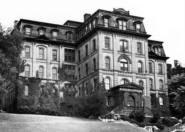 Exterior view of West Hall (west-northwest elevation, as viewed up the hill from Eighth Street, date unknown)