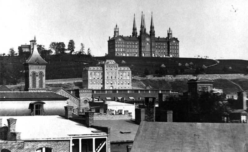 Main Building in center and Proudfit in background behind the steeple, 1900. Troy University building dominates the skyline.