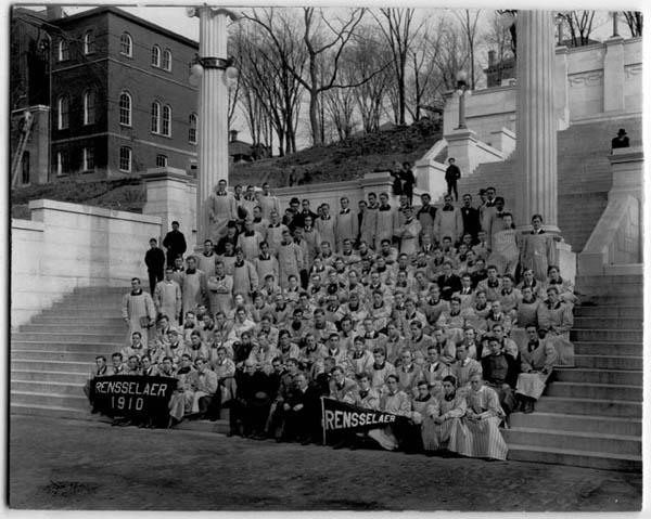 Photograph showing Rensselaer's Class of 1910 sitting at the bottom of the Approach steps, with instructors shown standing to left in photo as well as behind the students