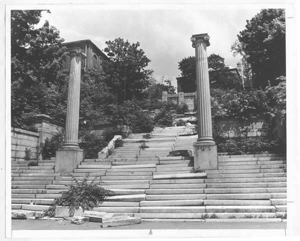 Photograph of the Approach in serious disrepair, with stone steps out of place and much plant overgrowth (view looking uphill toward Eighth Street, date likely circa 1970s