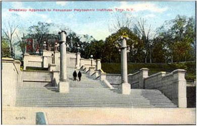 Early color-tinted photo/postcard showing two people walking up the Approach steps (view looking uphil, facing east-southeast; date unknown)
