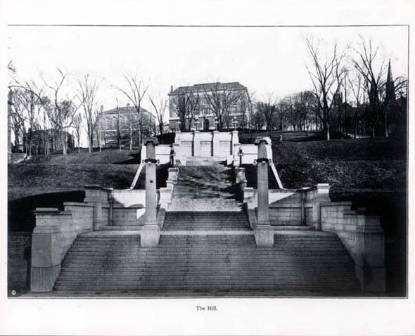 Early black-and-white of The Approach steps, looking eastward uphill toward Eighth Street, with the Main Building visible at top of steps.  Portion of the campus' original University Building visible at right (date unknown)