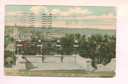 Front of a color-tinted photo postcard depicting the top of The Approach, looking west over the city of Troy