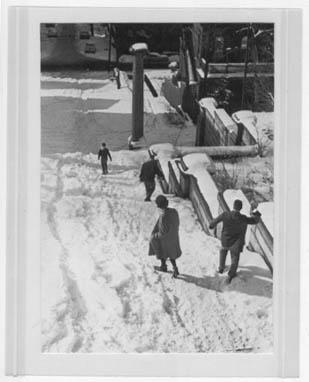 Photograph of students making their way down the snow-covered Approach steps (looking west-northwest downhill toward Troy, date unknown)