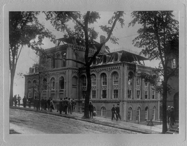 Photograph showing fire damage to Winslow Laboratory, including gutted top floors and broken windows (east-northeast elevation, circa 1904)