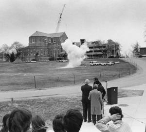 Photo depicting the small underground explosion that took place during the JEC's unique groundbreaking (April 18, 1975)