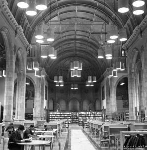 Students studying inside the open expanse of the Chapel, when it was temporarily being used as the campus Library (view facing east, date unknown)